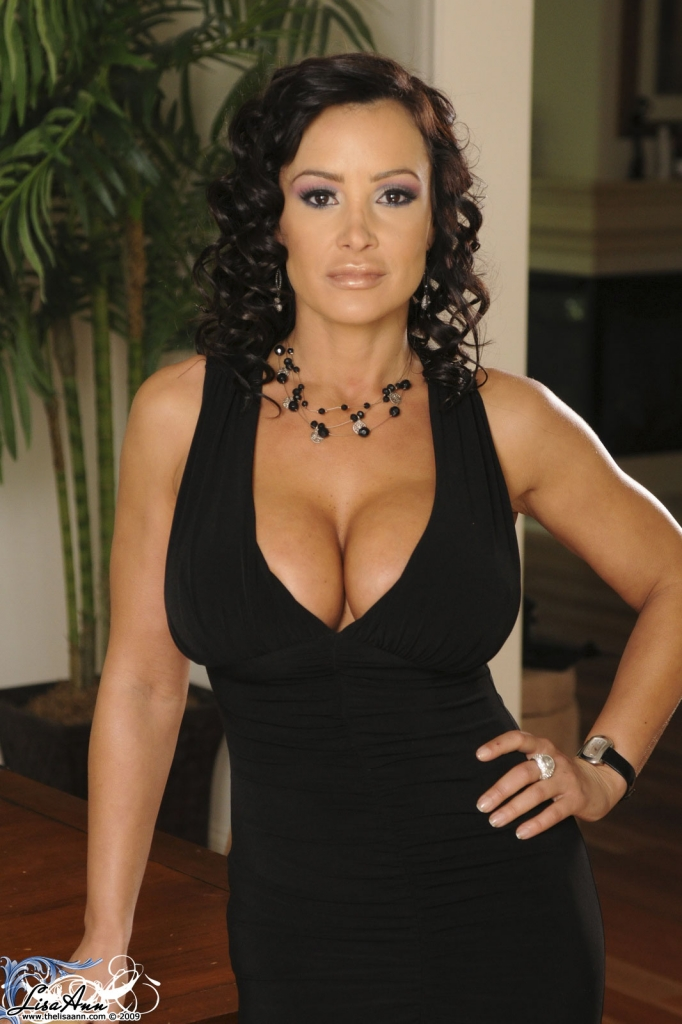 lisa ann shows off her cleavage in a little black party. Black Bedroom Furniture Sets. Home Design Ideas